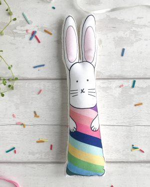 Soft bunny toy with rainbow stripes